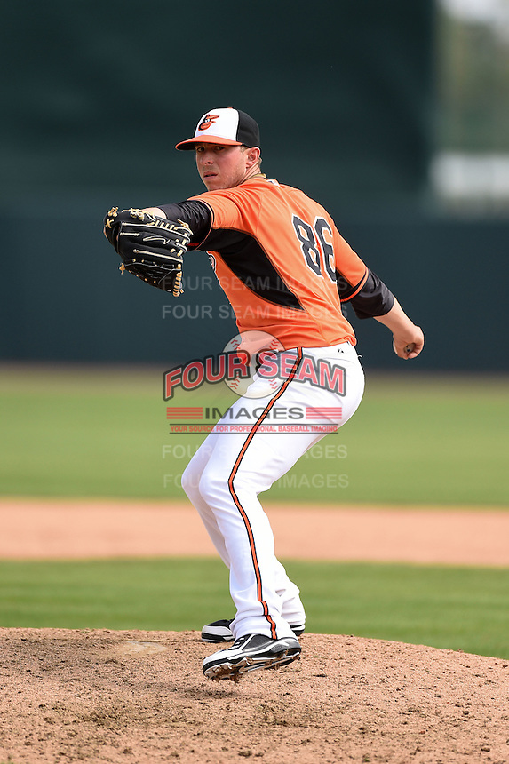 Baltimore Orioles pitcher Oliver Drake (86) during a spring training game against the Pittsburgh Pirates on March 23, 2014 at Ed Smith Stadium in Sarasota, Florida.  Baltimore and Pittsburgh tied 7-7.  (Mike Janes/Four Seam Images)