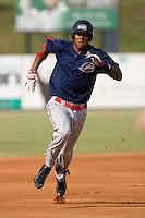 Michael Almanzar (23) of the Greenville Drive hustles into third base with a 2-out triple in the 2nd inning of play at Fieldcrest Cannon Stadium in Kannapolis, NC, Sunday August 10, 2008. (Photo by Brian Westerholt / Four Seam Images)