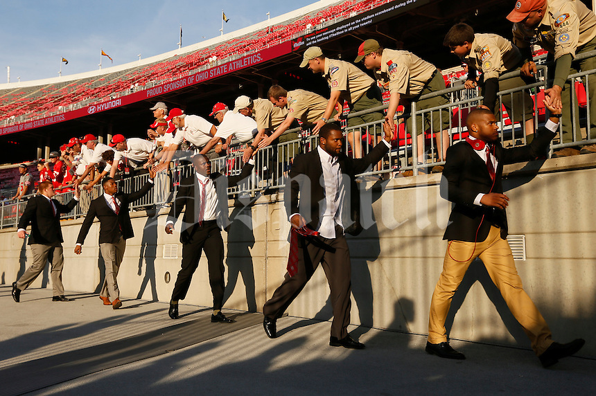 Ohio State University football players greet fans while taking the field before Saturday's NCAA Division I football game against Wisconsin at Ohio Stadium in Columbus on September 28, 2013. (Barbara J. Perenic/Columbus Dispatch)