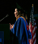 Deliana Andrea Escobari Ocampo, student speaker, addresses fellow classmates Sunday, June 11, 2017, during the DePaul University College of Computing and Digital Media and the College of Communication commencement ceremony at the Allstate Arena in Rosemont, IL. (DePaul University/Jamie Moncrief)