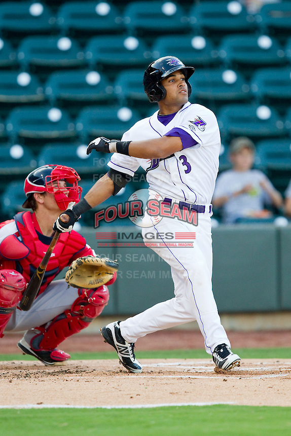 Micah Johnson (3) of the Winston-Salem Dash follows through on his swing against the Salem Red Sox at BB&T Ballpark on August 15, 2013 in Winston-Salem, North Carolina.  The Red Sox defeated the Dash 2-1.  (Brian Westerholt/Four Seam Images)
