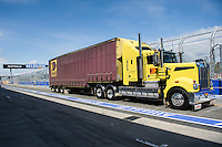 MELBOURNE, 11 March - A transport truck delivers the first race cars ahead of the 2012 Formula One Australian Grand Prix at the Albert Park Circuit in Melbourne, Australia. (Photo Sydney Low / syd-low.com)