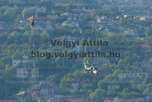 Hungarian Military Mi-24 combat helicopter flies above downtown Budapest during a shooting flight of the fifth movie in the Die Hard series titled Good Day to Die Hard in Budapest, Hungary on June 06, 2012. ATTILA VOLGYI