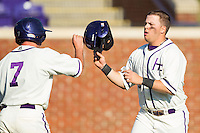 Dominic Fazio (32) of the High Point Panthers is congratulated by teammate Dane McDermott (7) after scoring a run against the Bowling Green Falcons at Willard Stadium on March 9, 2014 in High Point, North Carolina.  The Falcons defeated the Panthers 7-4.  (Brian Westerholt/Four Seam Images)