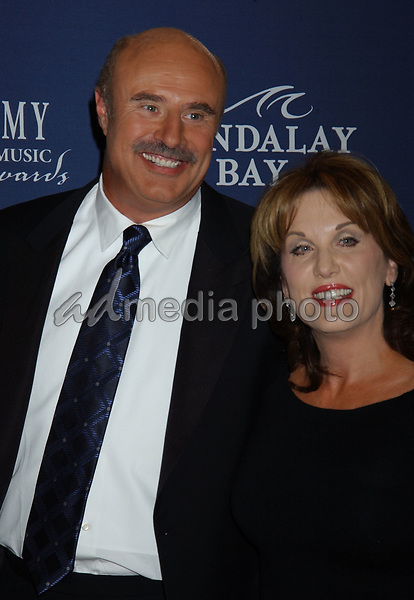 May 26, 2004; Las Vegas, NV, USA; Talk Show Host Dr. PHIL McGRAW and wife Amy McGraw during the 39th Annual Academy of Country Music Awards held at Mandalay Bay Resort and Casino. Mandatory Credit: Photo by Laura Farr/AdMedia. (©) Copyright 2004 by Laura Farr