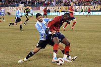 Ever Banega (20) of Argentina and Jozy Altidore (17) of the United States battles for the ball. The United States (USA) and Argentina (ARG) played to a 1-1 tie during an international friendly at the New Meadowlands Stadium in East Rutherford, NJ, on March 26, 2011.
