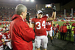 Matt Lepay introduces Wisconsin Badgers full back Bradie Ewing (34) during the Big Ten Conference Leaders Division Trophy presentation after an NCAA Big Ten Conference college football game against the Penn State Nittany Lions on November 26, 2011 in Madison, Wisconsin. The Badgers won 45-7. (Photo by David Stluka)