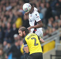Bolton Wanderers Sammy Ameobi jumps with Burton Albion's John Brayford<br /> <br /> Photographer Mick Walker/CameraSport<br /> <br /> The EFL Sky Bet Championship - Burton Albion v Bolton Wanderers - Saturday 28th April 2018 - Pirelli Stadium - Burton upon Trent<br /> <br /> World Copyright &copy; 2018 CameraSport. All rights reserved. 43 Linden Ave. Countesthorpe. Leicester. England. LE8 5PG - Tel: +44 (0) 116 277 4147 - admin@camerasport.com - www.camerasport.com