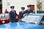 23/7/2015.    Graduating from the Garda College in Templemore this Thursday were new Gardai Emmet Lindsay, Easkey, Sligo who will be stationed in Dundalk, Dara Melia, Annaghdown, Galway who will be stationed in Mullingar and Eoin McDonagh, Miltown Malbay, Clare who will be stationed in Roxboro, Limerick pictured with former Garda Commissioner Larry Wren's staff car a 1982 Ford Granada.<br /> Photograph Liam Burke/Press 22