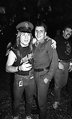 IRON MAIDEN - Bruce Dickinson and an admirer from the Polish Militia or communist police in Poznan Poland - August 1984.  Photo credit: George Bodnar Archive/IconicPix
