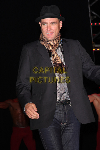 VINNIE JONES .Contestants enter the House on the Opening Night of Celebrity Big Brother, Elstree Studios, London, England, UK, .January 3rd 2010.CBB BB half length hat black jeans jacket blazer scarf brown grey gray trilby  .CAP/ROS.©Steve Ross/Capital Pictures