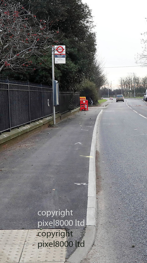 pix shows: Crash scene today in Hayes where three teens died on Friday night. <br /> <br /> Red dots emphasis the area of police markings on the pavement<br /> <br /> Bus stop near Esso garage on  Shepiston Lane -<br /> <br /> scrapes can been seen on the wall and a brick pillar was destroyed  <br /> <br /> <br /> <br /> Pic by Gavin Rodgers/Pixel8000 Ltd