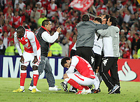 BOGOTA -COLOMBIA, 9-07-2013. Tristeza de los jugadres  de Santa Fe de Colombia al ser eliminados por  Olimpia de Paraguay  , partido de la semifinal de la Copa Bridgestone  Libertadores de América , jugado en el estadio Nemesio Camacho El Campín de la ciudad de Bogotá./ players sadness Santa Fe of Colombia to be eliminated by Olimpia of Paraguay, semifinal match of the Copa Libertadores Bridgestone, played at the Estadio Nemesio Camacho El Campin in Bogota.<br /> . Photo: VizzorImage/ Felipe Caicedo/ STAFF