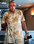 Dick Kraus taking pictures of retires at Dinosaur Brunch at diner in Farmingdale on Monday September 19, 2005. (Newsday Photo / Jim Peppler).