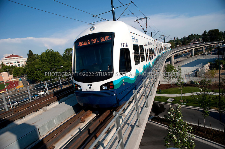 "7/28/2009--Seattle, WA, USA..A Sound Transit Link train pulls out of the Mount Baker Station on it's way to Tukwila, south of Seattle..The Sound Transit Link Light Rail opened in Seattle on July 20th 2009, after decades of planning and political wrangling. Construction of the city's new mass transit system took five years and cost $2.3 billion. By the end of the 2009 Sound Transit says light rail will reach Sea-Tac Airport; the train currently runs 14 miloes from the downtown Westlake station to Tukwila, south of Seattle, with extensions planned to run north and east out of the city.The first efforts to build modern rail transit in the Seattle area began about 50 years ago. A comprehensive plan was defeated by voters three times (1968, 1970, 1995), and then a shortened, ""starter"" system was passed in 1996. ..©2009 Stuart Isett. All rights reserved."