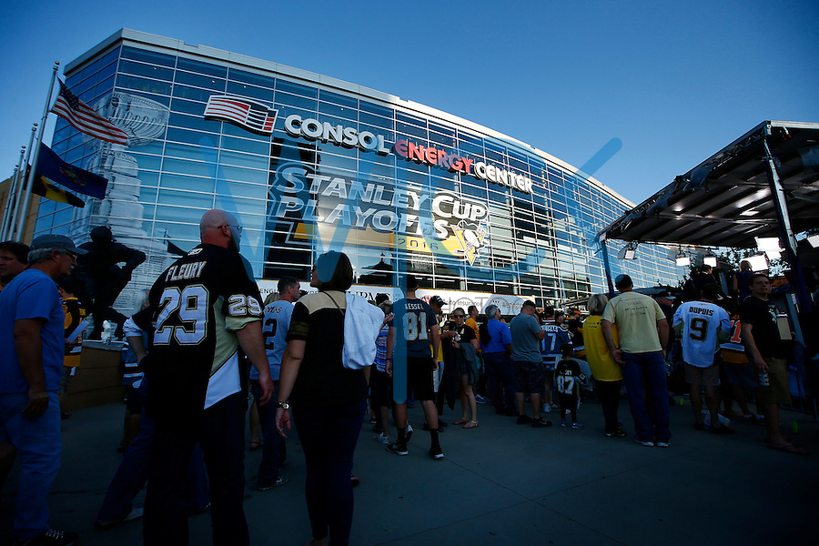Fans enter Consol Energy Center prior to game one of the Stanley Cup Final between the Pittsburgh Penguins and the San Jose Sharks in Pittsburgh, Pennslyvania on May 30, 2016. (Photo by Jared Wickerham / DKPS)