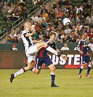 CARSON, CA – APRIL 30, 2011: New England Revolution forward Rajko Lekic (10) and Chivas USA defender Andrew Boyens race for the ball during the match between Chivas USA and New England Revolution at the Home Depot Center, April 30, 2011 in Carson, California. Final score Chivas USA 3, New England Revolution 0.