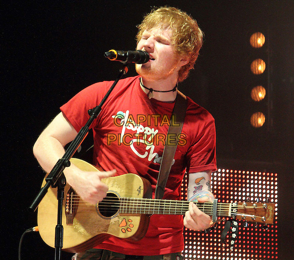 Ed Sheeran.V Festival 2012 - Day One, Hylands Park, Chelmsford, Essex, England..August 18th 2012.on stage in concert live gig performance music half length red t-shirt guitar beard facial hair singing .CAP/JIL.©Jill Mayhew/Capital Pictures