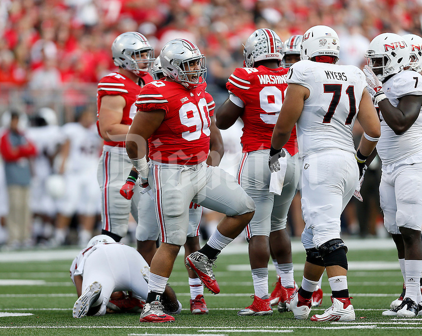 Ohio State Buckeyes defensive lineman Tommy Schutt (90) celebrates a tackle during the second half of the NCAA football game between the Ohio State Buckeyes and the Northern Illinois Huskies at Ohio Stadium on Saturday, September 19, 2015. (Columbus Dispatch photo by Jonathan Quilter)