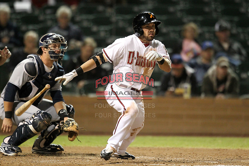 Salt River Rafters outfielder Adam Eaton #2 hitting with catcher Jason Hagerty in the background during an Arizona Fall League game against the Peoria Javelinas at HoHoKam Park on November 3, 2011 in Mesa, Arizona.  Salt River defeated Peoria 13-4.  (Mike Janes/Four Seam Images)