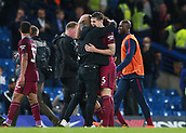 30th September 2017, Stamford Bridge, London, England; EPL Premier League football, Chelsea versus Manchester City; Manchester City manager Josep Guardiola and John Stones of Manchester City celebrate after the final whistle