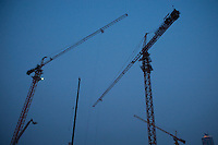 Evening horizontal view of construction cranes at a construction site near Jie Fang Bei Lu in the Heping District in Tiānjīn.  © LAN