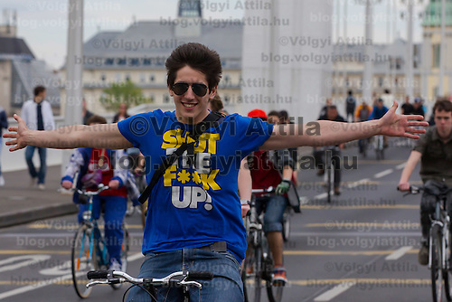 A boy participates the Critical Mass ride around the city on Earth Day that is demonstrating the importance and popularity of bicycle as a mean of everyday city transportation in Budapest, Hungary on April 22, 2012. ATTILA VOLGYI