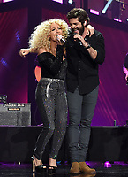 NASHVILLE, TN - JUNE 5: Kimberly Schlapman of Little Big Town and Thomas Rhett perform on the 2019 CMT Music Awards at Bridgestone Arena on June 5, 2019 in Nashville, Tennessee. (Photo by Frank Micelotta/PictureGroup)