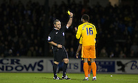 Aaron Amadi-Holloway of Wycombe Wanderers is shown a yellow card from Referee Brendan Malone during the Sky Bet League 2 rearranged match between Bristol Rovers and Wycombe Wanderers at the Memorial Stadium, Bristol, England on 1 December 2015. Photo by Andy Rowland.