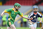 Zak Mc Inerney of Kilkishen/O Callaghan's Mills in action against Cathal Moloney of Bridgetown during their Schools Division 5 final at Cusack Park. Photograph by John Kelly