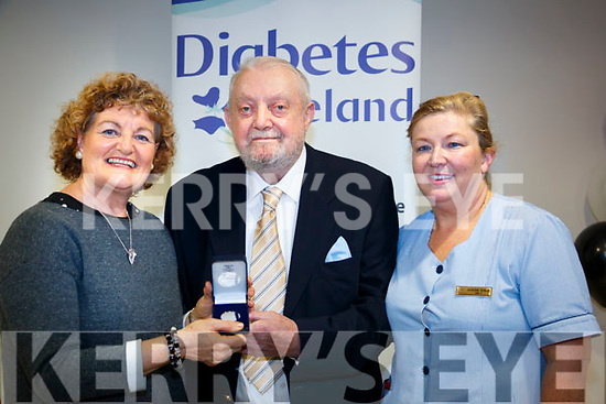 Dan O'Shea being honored with a gold medal as one of the longest living diabetics in Ireland. <br /> L-R: Pauline Lynch, Dan O'Shea and Catherine Quinlan