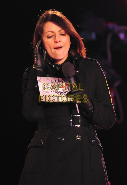 DAVINA McCALL.Is evicted from the Celebrity Big Brother House, Borehamwood, Herts, England, January 16th 2009..half length black coat gloves  microphone cards funny face .CAP/TTL .©TTL/Capital Pictures