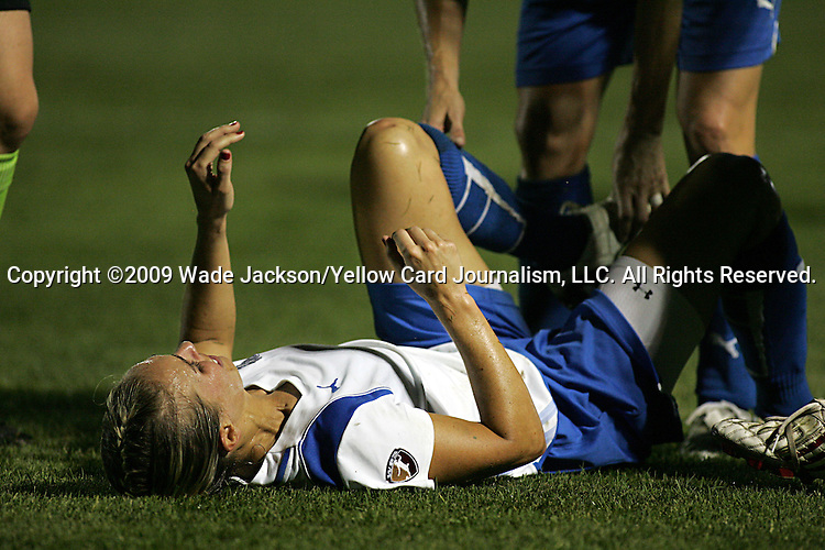 01 Aug 2009: Heather Mitts (ground) of the Breakers is in pain after an injury to her left knee.  Saint Louis Athletica defeated the visiting Boston Breakers 1-0 in a regular season Women's Professional Soccer game at Anheuser-Busch Soccer Park, in Fenton, MO.