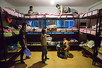 Blind and visually impaired Tibetan boy students wake up and get dressed in the morning at the boys' dormitory of the School for the Blind in Tibet, in the capital city of Lhasa, September 2016.