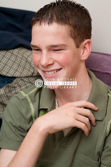 Portrait of teenager in hostel.