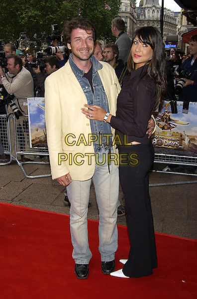 "GUEST.arrivals at premiere of.""Around the World in 80 Days"".Leicester Square, London.22 June 2004.CAP/PL.full length, denim, jean jacket.www.capitalpictures.com.sales@capitalpictures.com.©Capital Pictures"