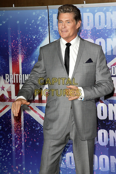 DAVID HASSELHOFF.Britain's Got Talent press launch at The May Fair Hotel, London, England, UK, April 13th 2011..half length photocall grey gray suit black tie white shirt hand .CAP/ROS.©Steve Ross/Capital Pictures