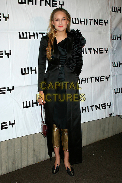 LEELEE SOBIESKI.The 2006 Whitney Gala celebrating Picasso and Modern Art at the Whitney Museum, New York, NY, USA..October 23rd, 2006.Ref: IW.full length black coat gold leggings ruffles.www.capitalpictures.com.sales@capitalpictures.com.©Ian Wilson/Capital Pictures