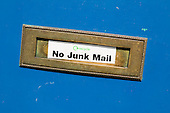 No Junk Mail sticker on a letterbox in Kentish Town, London.