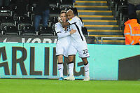 Andre Ayew of Swansea City celebrates scoring his side's second goal with tea mate Barrie McKay during the Sky Bet Championship match between Swansea City and Middlesbrough at the Liberty Stadium in Swansea, Wales, UK. Saturday 14 December 2019