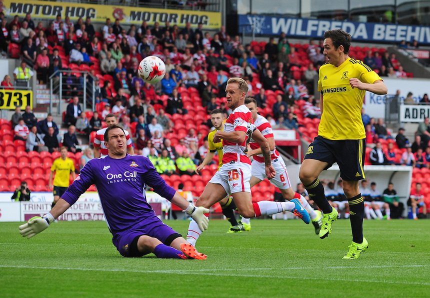 Doncaster Rovers' Thorsten Stuckmann makes a save at the feet of Middlesbrough&rsquo;s Stewart Downing<br /> <br /> Photographer Chris Vaughan/CameraSport<br /> <br /> Football - Pre-Season Friendly - Doncaster Rovers v Middlesbrough - Saturday 25th July 2015 - Keepmoat Stadium, Doncaster<br /> <br /> &copy; CameraSport - 43 Linden Ave. Countesthorpe. Leicester. England. LE8 5PG - Tel: +44 (0) 116 277 4147 - admin@camerasport.com - www.camerasport.com