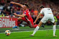 Connor Roberts of Connor Roberts of Wales is fouled by Shahiyar Rahimov of Azerbaijan during the UEFA Euro 2020 Qualifier match between Wales and Azerbaijan at the Cardiff City Stadium in Cardiff, Wales, UK. Friday 06, September 2019