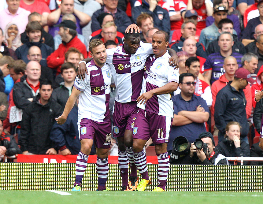 Aston Villa's Christian Benteke celebrates scoring his sides first goal 1-1 from a penalty kick<br /> <br />  (Photo by Karyn Haddon/CameraSport) <br /> <br /> Football - Barclays Premiership - Arsenal v Aston Villa - Saturday 17th August 2013 - The Emirates Stadium - London<br /> <br /> &copy; CameraSport - 43 Linden Ave. Countesthorpe. Leicester. England. LE8 5PG - Tel: +44 (0) 116 277 4147 - admin@camerasport.com - www.camerasport.com