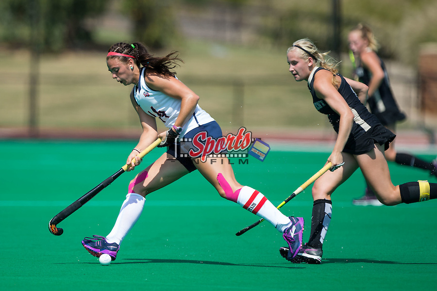 Sarah Gipe (14) of the Liberty Flames tries to keep the ball away from Emily Conroe (18) of the Wake Forest Demon Deacons during first half action at Kentner Stadium on September 20, 2015 in Winston-Salem, North Carolina.  The Demon Deacons defeated the Flames 2-1.  (Brian Westerholt/Sports On Film)