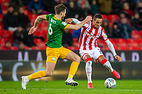 12th February 2020; Bet365 Stadium, Stoke, Staffordshire, England; English Championship Football, Stoke City versus Preston North End; Tom Ince of Stoke City pulls the ball back against Ben Davies of Preston North End