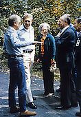 United States President Jimmy Carter, left, chats with Prime Minister Menachem Begin, right, and his party after their meeting at Camp David, near Thurmont, Maryland prior to their meeting on Friday, September 16, 1978.  From left to right: President Carter; Defense Minister Ezer Weizman of Israel, Aliza Begin, wife of the Prime Minister; and Prime Minister Begin..Credit: White House via CNP