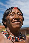 Xingu Indigenous Park, Mato Grosso State, Brazil. Aldeia Tuba Tuba (Yudja). Cacique Yaiya Yudja, painted and decorated for a celebration party.