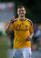 Robbie Rogers (14) of the LA Galaxy gives a fan the thumbs up during a third round match in the US Open Cup at WakeMed Soccer Park in Cary, NC.  The Carolina Railhawks defeated the LA Galaxy, 2-0.