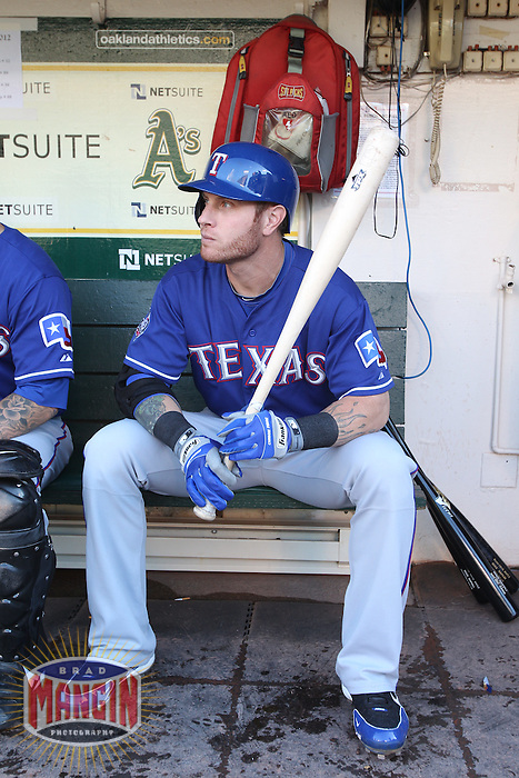 OAKLAND, CA - JULY 17:  Josh Hamilton #32 of the Texas Rangers gets ready in the dugout before the game against the Oakland Athletics at O.co Coliseum on Tuesday, July 17, 2012 in Oakland, California. Photo by Brad Mangin