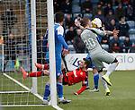 Keeper Jim Atkinson saves from Nicky Clark